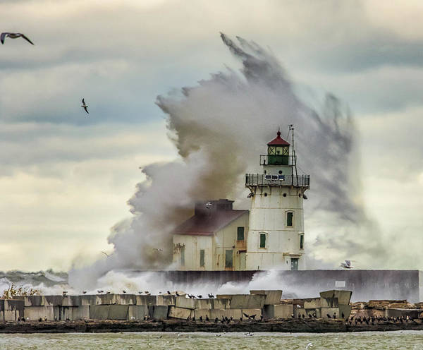 Photograph - Waves Over The Lighthouse In Cleveland. by Richard Kopchock