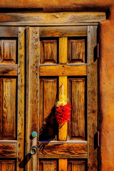 Wall Art - Photograph - Weathered Door With Chillies by Garry Gay
