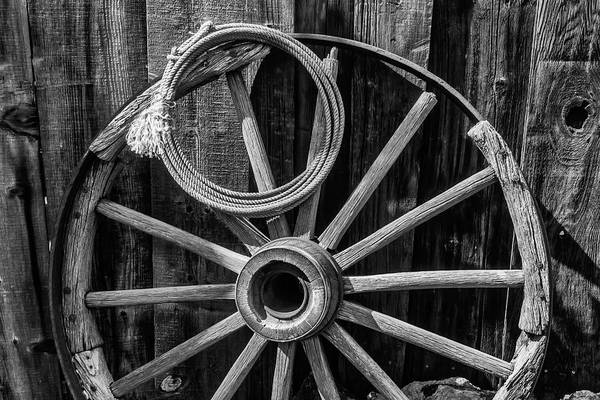 Roping Photograph - Western Rope And Wooden Wheel In Black And White by Garry Gay