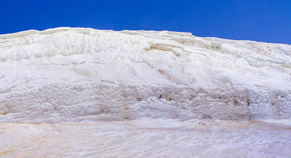 Photograph - Wet White Limestone Formations In Pamukkale by Sun Travels