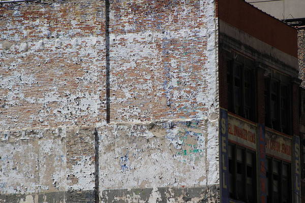 Photograph - White Flaking Paint On Brick Building by Colleen Cornelius