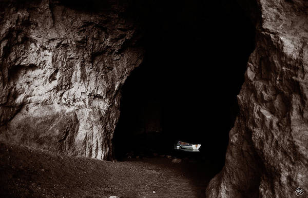 Photograph - White Rowboat In A Dark Grotto by Wayne King