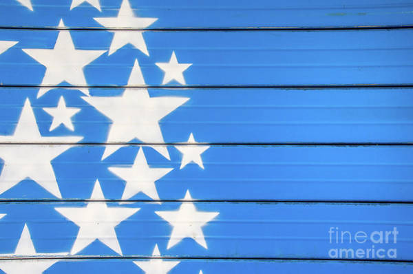 Photograph - White Stars On Blue Background Painted On A Closed Shutter by Luca Lorenzelli
