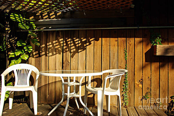 Wall Art - Photograph - White Table With Chairs by Zal Latzkovich