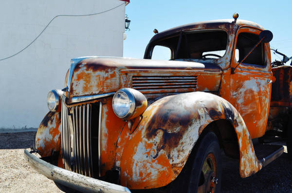 Photograph - Wigwam Motel Route 66 Orange Ford Truck by Kyle Hanson