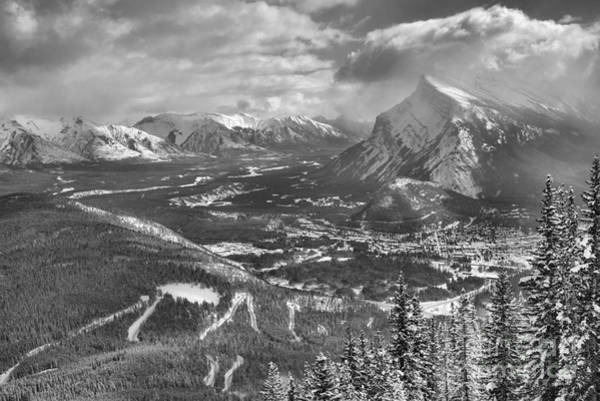 Photograph - Winter Clouds Over Banff Town Black And White by Adam Jewell