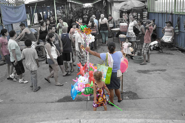 La Libertad Photograph - Woman And Kid Toys Vendor by Totto Ponce