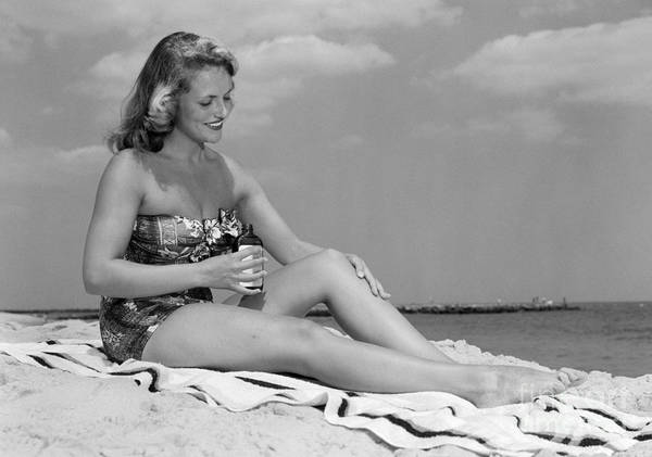 Photograph - Woman Applying Suntan Lotion, C.1950s by H Armstrong Roberts and ClassicStock