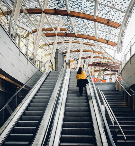 Photograph - Woman Going Up Escalator In Milan, Italy by Alexandre Rotenberg
