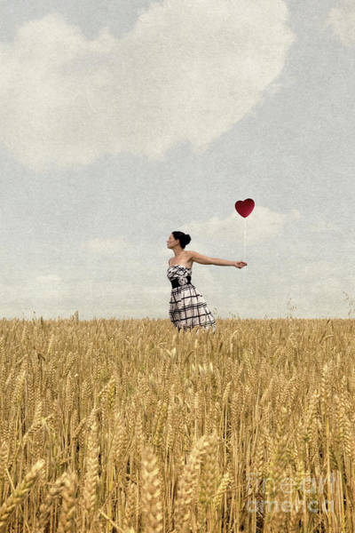 Photograph - Woman In Corn Field With Heart Shaped Balloon by Clayton Bastiani