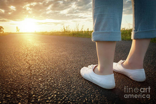 Straight Ahead Wall Art - Photograph - Woman In White Sneakers Standing On Asphalt Road Towards Sun. Travel, Freedom Concepts. by Michal Bednarek