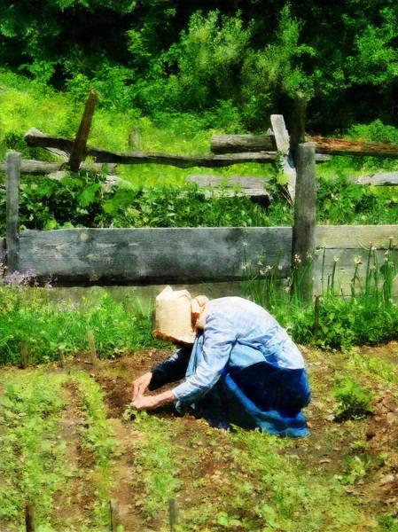 Photograph - Woman Planting Garden by Susan Savad