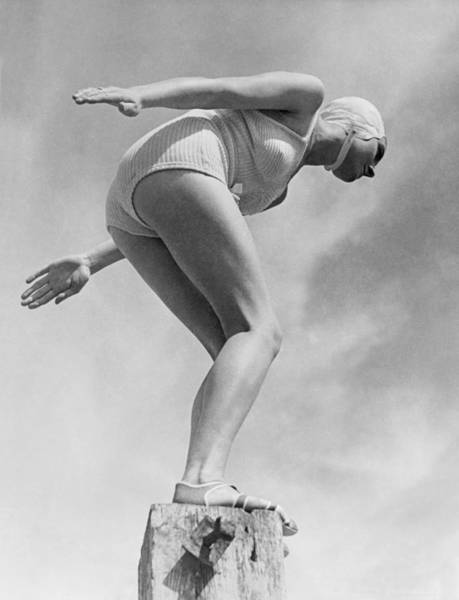 Plunge Photograph - Woman Ready To Dive by Underwood Archives