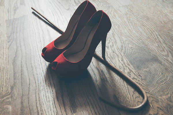 Mistress Photograph - Woman Red High Heel Shoes And Rattan School Cane. Strict Domination Bdsm Concept. by Fetish Photo