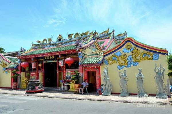 Photograph - Woman Sits Outside Chinese Temple With Urn And Deity Statues Pattani Thailand by Imran Ahmed