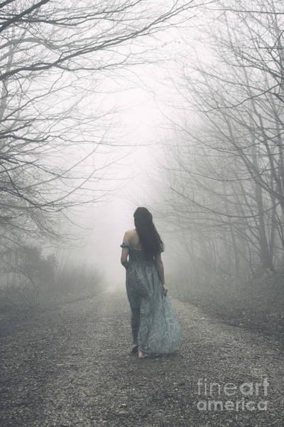 Photograph - Woman Walking Along Foggy Path by Clayton Bastiani