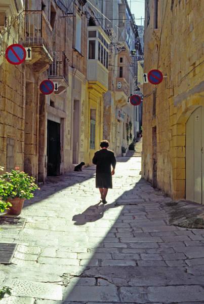 Photograph - Woman Walking Ancient Street by Thomas R Fletcher
