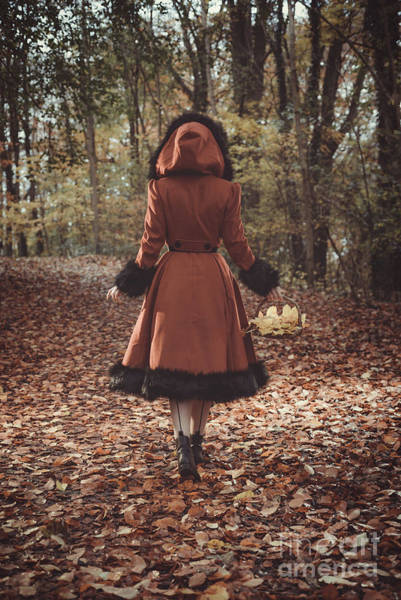 Wall Art - Photograph - Woman Walking In Autumn Leaves by Amanda Elwell