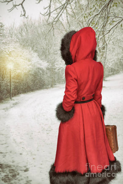 Wall Art - Photograph - Woman Walking In Snow by Amanda Elwell