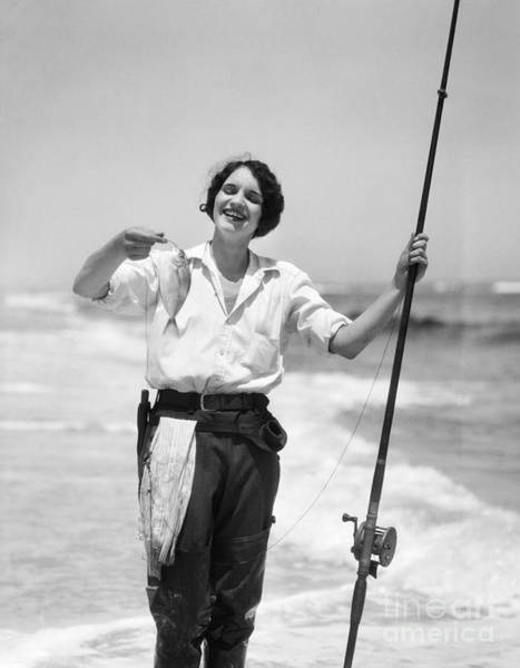 Angling Photograph - Woman With Freshly Caught Fish by H. Armstrong Roberts/ClassicStock