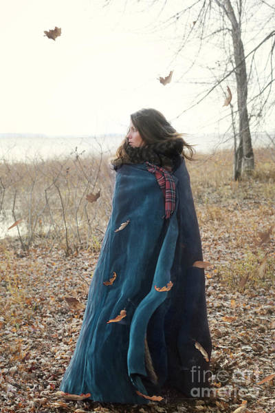 Photograph - Woman Wrapping A Cape Around Herself And Looking Out To The Wate by Sandra Cunningham