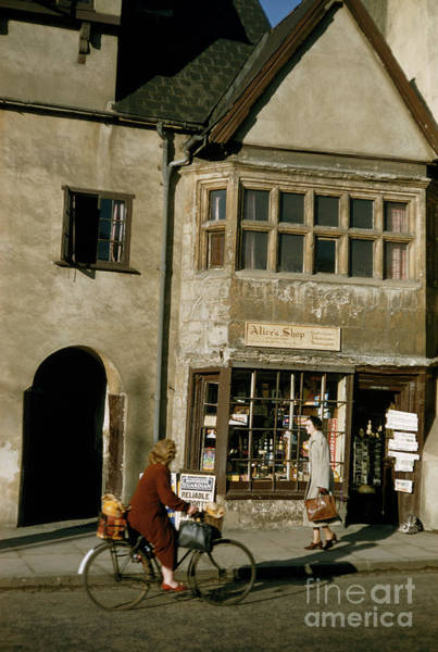 Photograph - Women Pass Sweet Shop Named After Alice Of Alice In Wonderland by Kathleen Revis