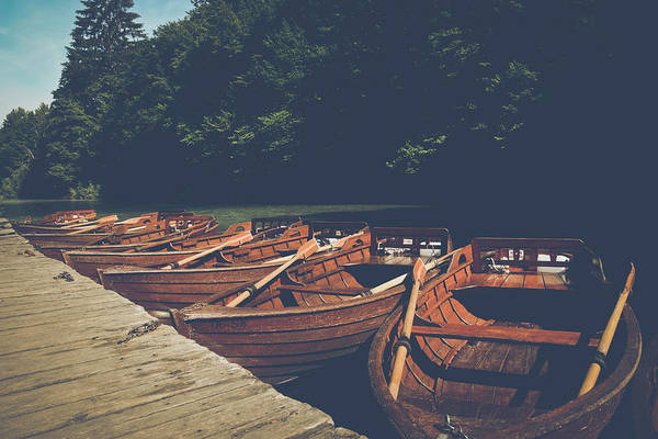 Photograph - Wooden Boats Docked In Lake With Instagram Retro Style Filter by Brandon Bourdages