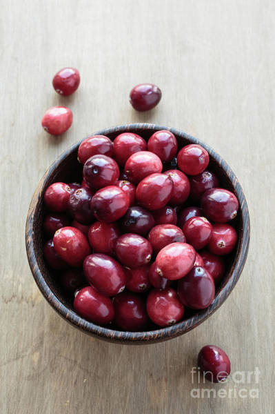 Photograph - Wooden Bowl Of Ripe Red Cranberries by Edward Fielding
