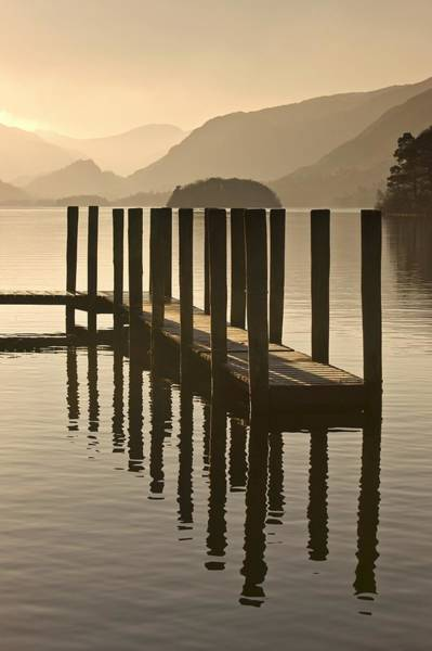 Peacefulness Photograph - Wooden Dock In The Lake At Sunset by John Short