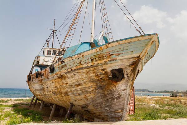 Sea Wall Art - Photograph - Fishing Boat Wreck In Latsi by Iordanis Pallikaras