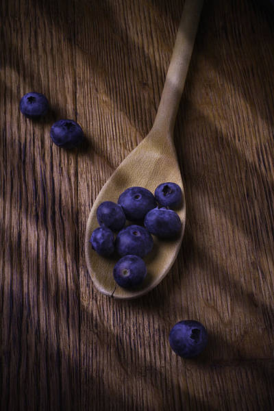 Blue Berry Photograph - Wooden Spoon With Blueberries by Garry Gay