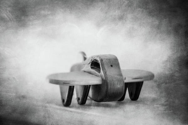 Wall Art - Photograph - Wooden Toy Airplane On Fireplace Mantel In Bw by YoPedro