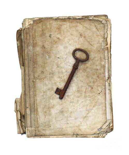 Wall Art - Photograph - Worn And Tattered Book And Old Rusty Key by Michal Boubin