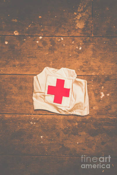 Photograph - Ww2 Nurse Cap Lying On Wooden Floor by Jorgo Photography - Wall Art Gallery