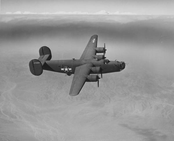 Grey Skies Wall Art - Photograph - Wwii Us Aircraft In Flight by American School