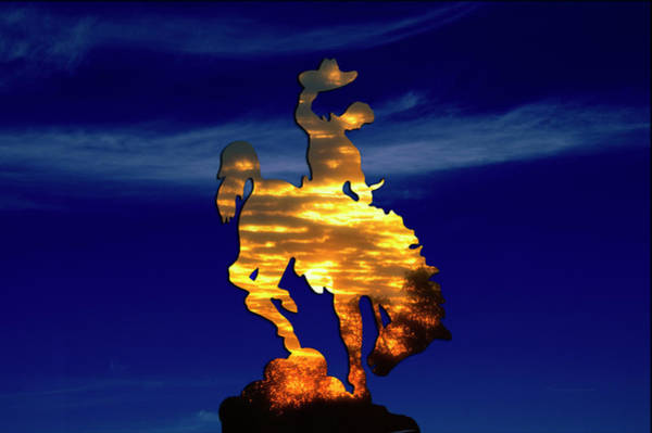 Wall Art - Photograph - Wyoming Sunset On The Cowboy And His Bucking Bronco by Thomas Woolworth