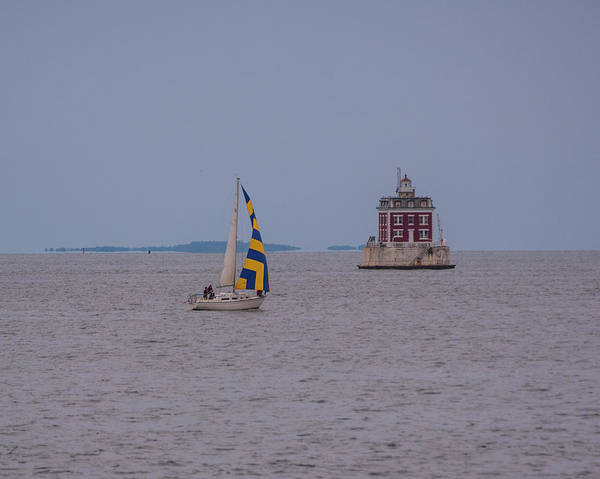 Wall Art - Photograph - Yellow And Blue Sailboat Passing By The New London Ledge Lighthouse Ct Connecticut by Toby McGuire