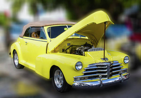 Photograph - Yellow Antique Restored Automobile by Bob Slitzan