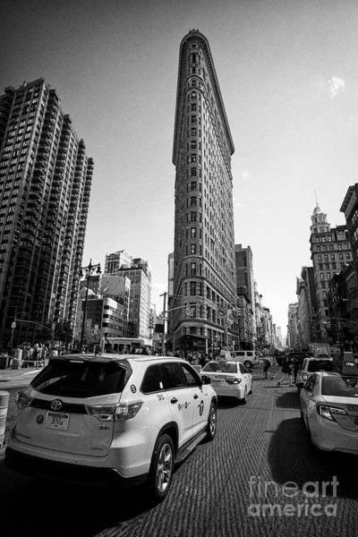 Wall Art - Photograph - yellow cabs and the flatiron originally the fuller building manhattan New York City USA by Joe Fox