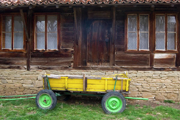 Photograph - Yellow Cart And Green Wheels  by Cliff Norton