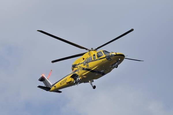 Photograph - Yellow Commuter Helicopter In Flight by Bradford Martin