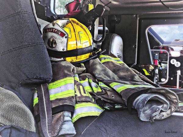 Photograph - Yellow Fire Helmet In Fire Truck by Susan Savad