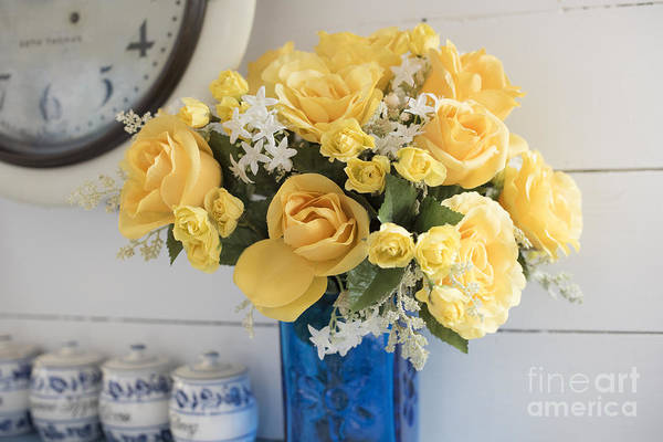 Wall Art - Photograph - Yellow Flowers In A Blue Vase by Juli Scalzi
