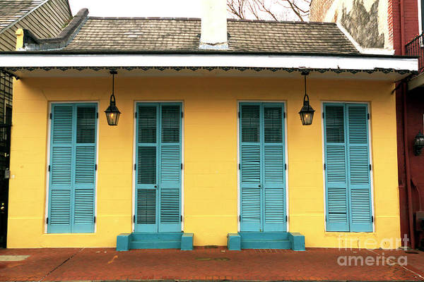 Photograph - Yellow Row House In New Orleans by John Rizzuto