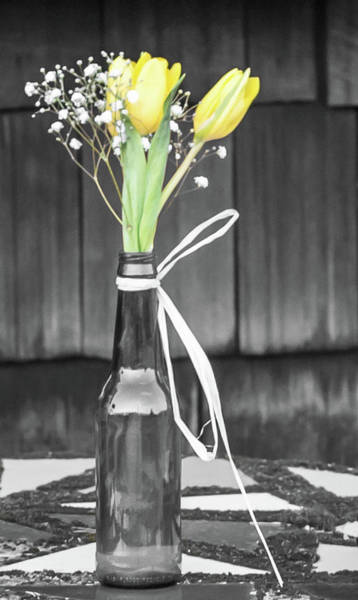 Photograph - Yellow Tulips In Glass Bottle by Terry DeLuco