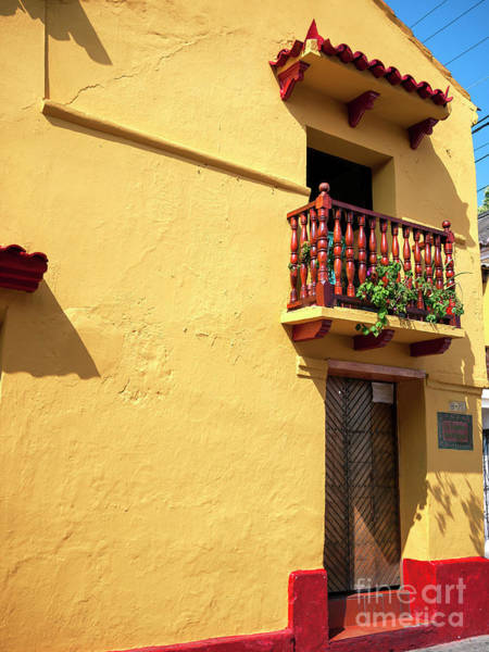 Photograph - Yellow Wall In Cartagena by John Rizzuto