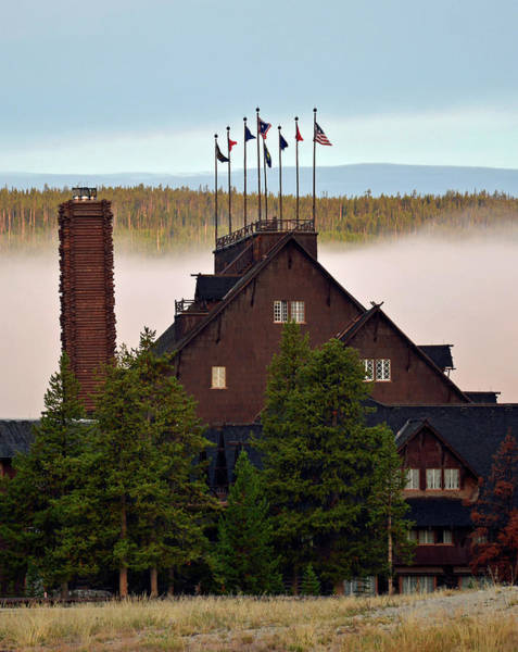 Photograph - Yellowstone's Old Faithful Inn With Morning Fog by Bruce Gourley