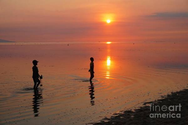 Photograph - Young Fishermen At Sunset by Christopher Shellhammer