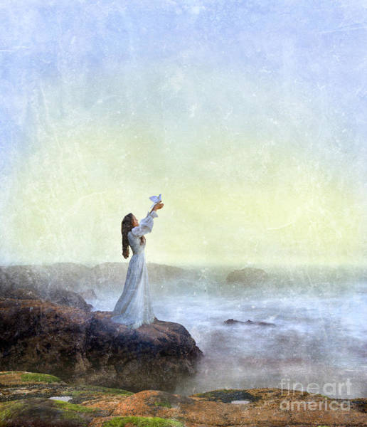 Wall Art - Photograph - Young Lady Releasing A Dove By The Sea by Jill Battaglia