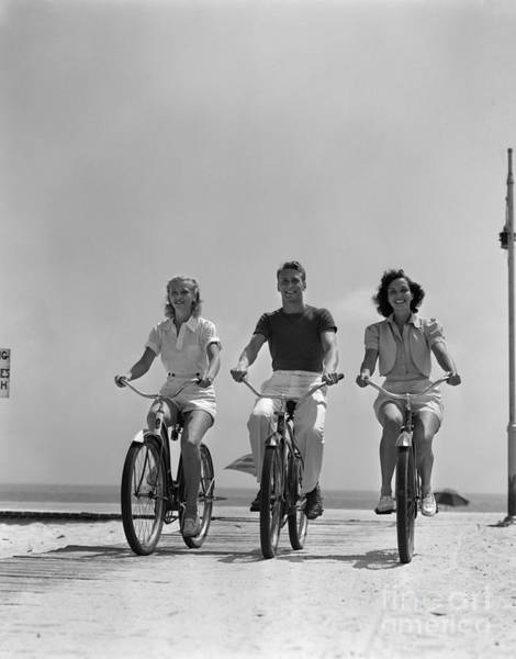Photograph - Young People Biking On The Beach by H Armstrong Roberts and ClassicStock